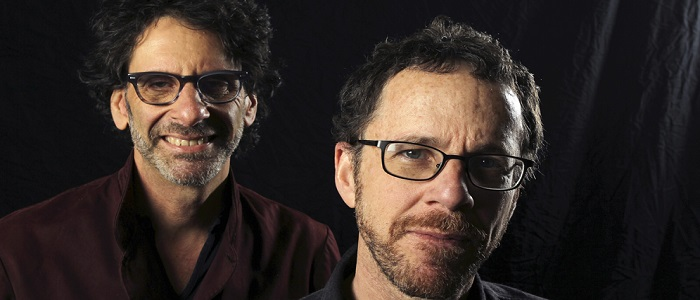 """Directors Joel Coen (L) and Ethan Coen pose for a photo in Los Angeles, California, November 15, 2013. For their new film, """"Inside Llewyn Davis,"""" the brothers Coen painted themselves into this corner: They needed an actor for the title role of a struggling folk singer in the early 1960s who could carry an entire movie, be in every scene, convince the audience he was a musician and play songs live in their entirety multiple times. Oscar Isaac, 33, a Guatemala-born, Miami-raised actor and musician trained at the Juilliard School, turned out to be the ticket. Picture taken November 15. To match story FILM-INSIDELLEWYNDAVIS/  REUTERS/David McNew (UNITED STATES - Tags: ENTERTAINMENT SOCIETY PORTRAIT) - RTX162M8"""