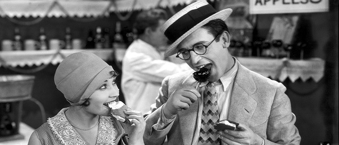 HLE104012 Speedy 1928 enjoys carnival food w-date.tif